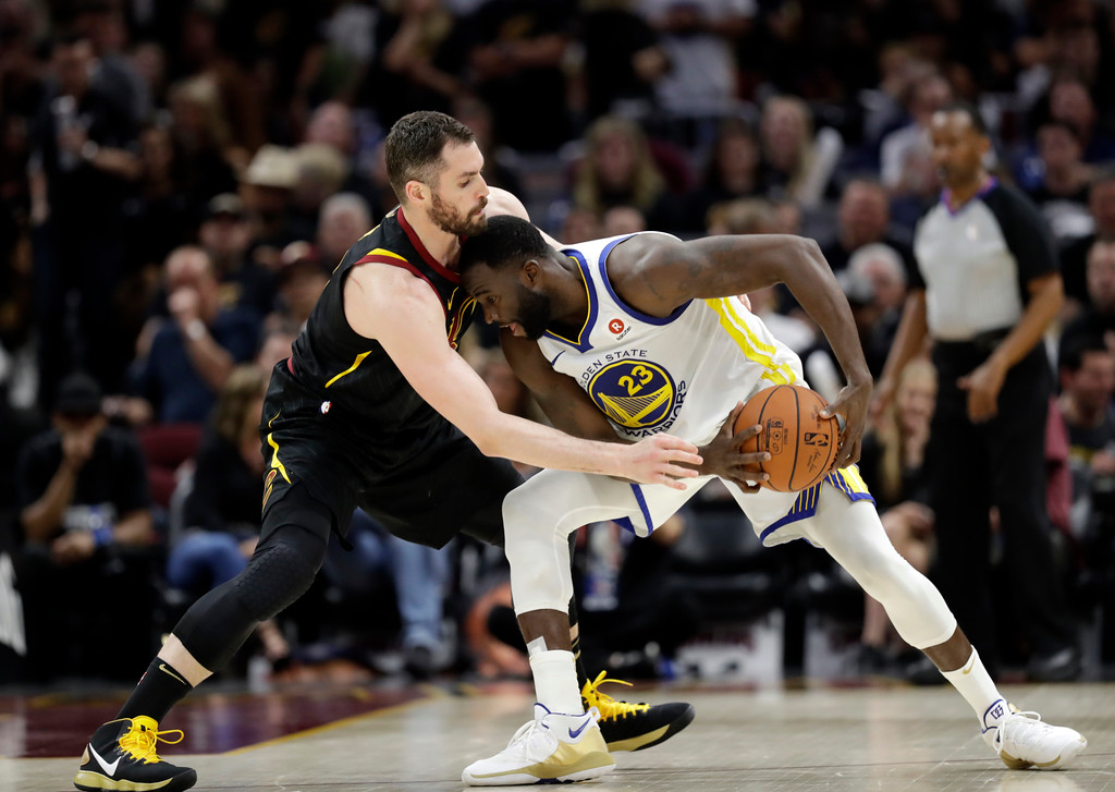 . Golden State Warriors\' Draymond Green is defended by Cleveland Cavaliers\' Kevin Love during the second half of Game 4 of basketball\'s NBA Finals, Friday, June 8, 2018, in Cleveland. (AP Photo/Tony Dejak)