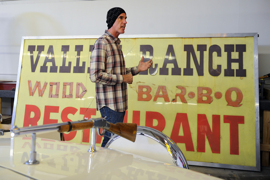 . Tommy Gelinas, owner of the Valley Relics Museum in Chatsworth, stands by a Valley Ranch Restaurant sign in his museum that is set to open October 12. (Photo by Michael Owen Baker/L.A. Daily News)