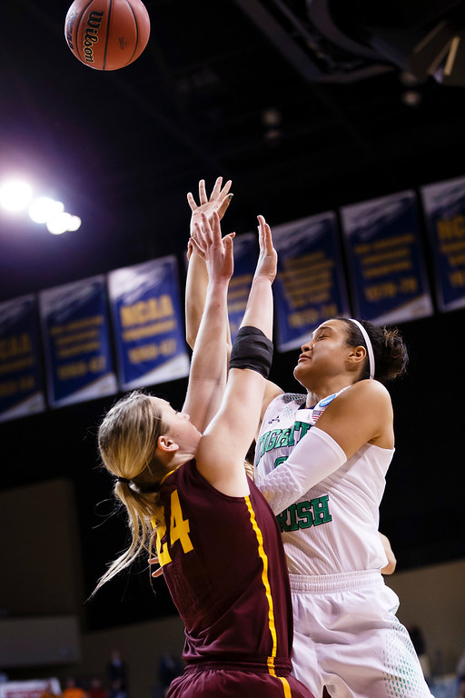 . Notre Dame\'s Kayla McBride shoots on Arizona State forward Kelsey Moos (24) during the second half in a second-round game in the NCAA women\'s college basketball tournament in Toledo, Ohio, Monday, March 24, 2014. Notre Dame defeated Arizona State 84-67. (AP Photo/Rick Osentoski)
