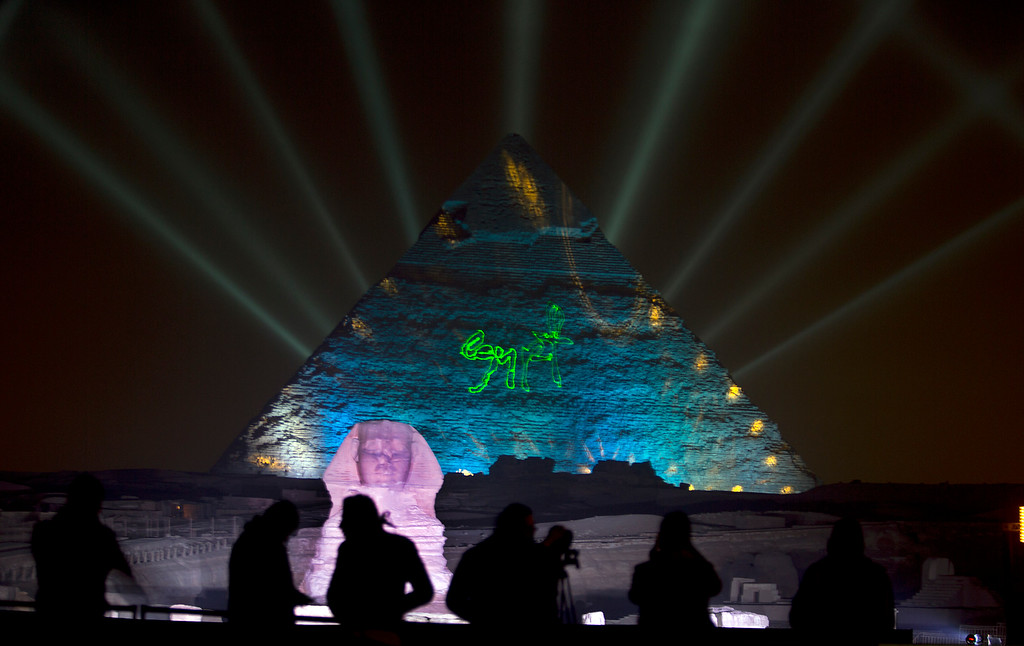 . Visitors watch light show on the historical site of Giza Pyramids and Sphinx to celebrate the New Year in Egypt, Sunday, Jan. 1, 2017. (AP Photo/Amr Nabil)