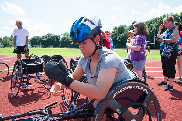 08/08/19 Wesley Bunnell | Staff Stephanie Marquez fixes her racing gloves before the track and field events at the Hospital for Special Care's Ivan Lendl Adaptive Sports Camp at Berlin High School on Thursday August 9, 2019.
