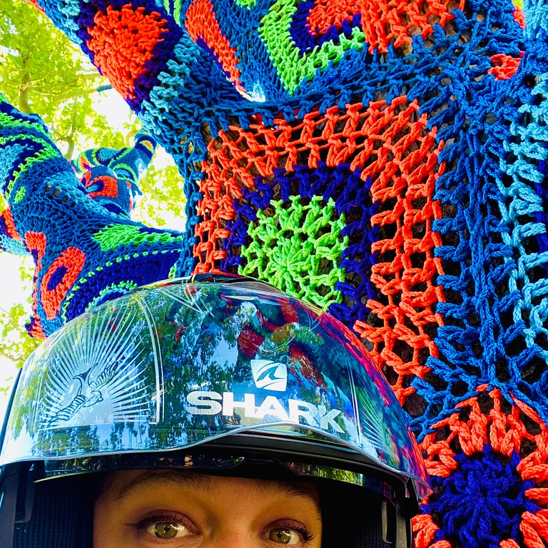 Selfie with a yarn-bombed tree