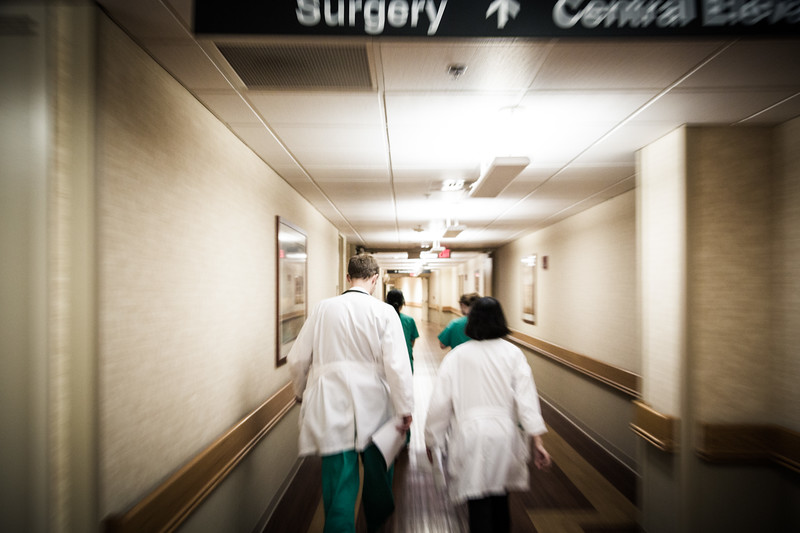 Quickly Following Doctor and Staff Down Hallway