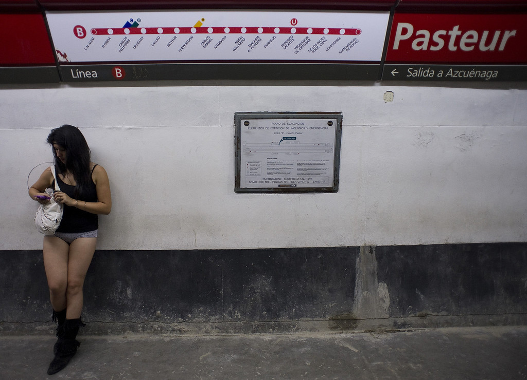 """. A woman taking part in the \""""No Pants Subway Ride\"""" waits at a metro station in Buenos Aires on January 12, 2014. \""""No Pants Subway Ride\"""" is an annual event in which transit passengers ride trains without wearing pants in January. The event is observed in dozens of cities worldwide.   ALEJANDRO PAGNI/AFP/Getty Images"""