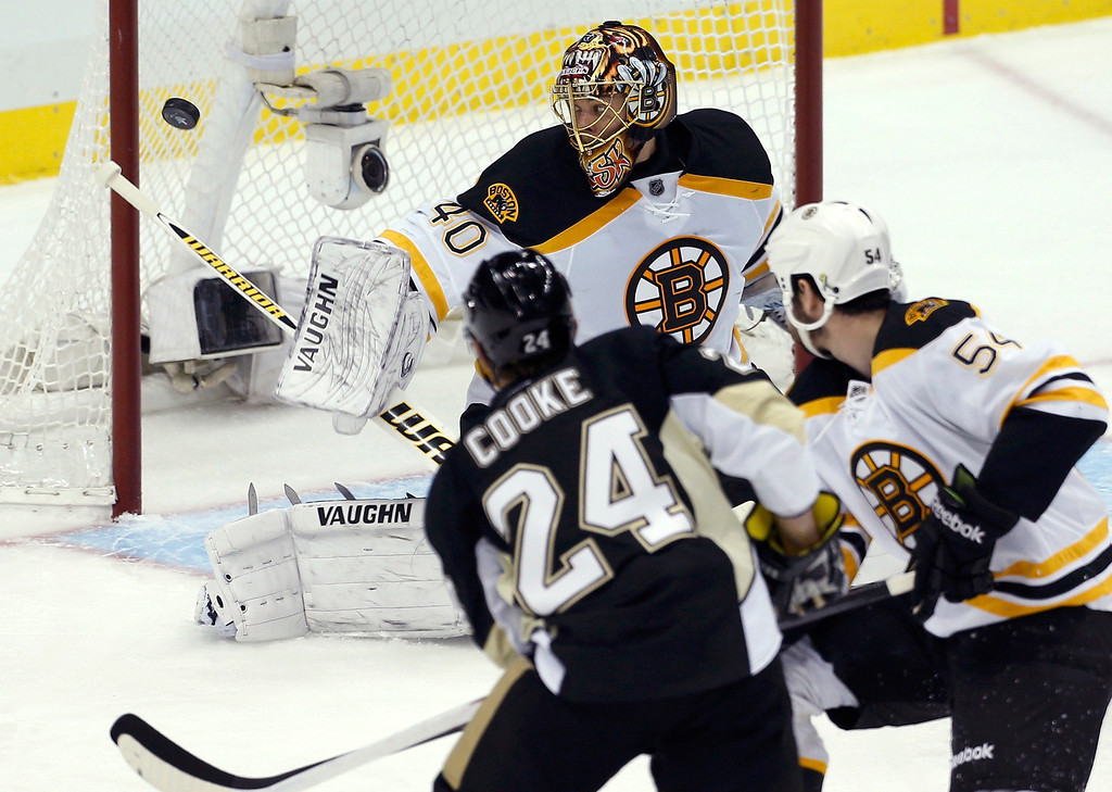 . Boston Bruins goalie Tuukka Rask (40) makes a save on Pittsburgh Penguins left wing Matt Cooke (24) in the first period of Game 2 of their NHL Eastern Conference finals hockey series in Pittsburgh, Pennsylvania, June 3, 2013. REUTERS/Jason Cohn