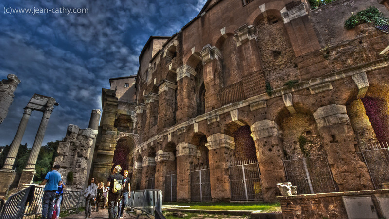 HDR - At first glance you may think you're looking at the Colosseum but in fact it's just another amphitheater in Rome. Note that they have excavated these ruins and there are house still on top of the ruins... cool !