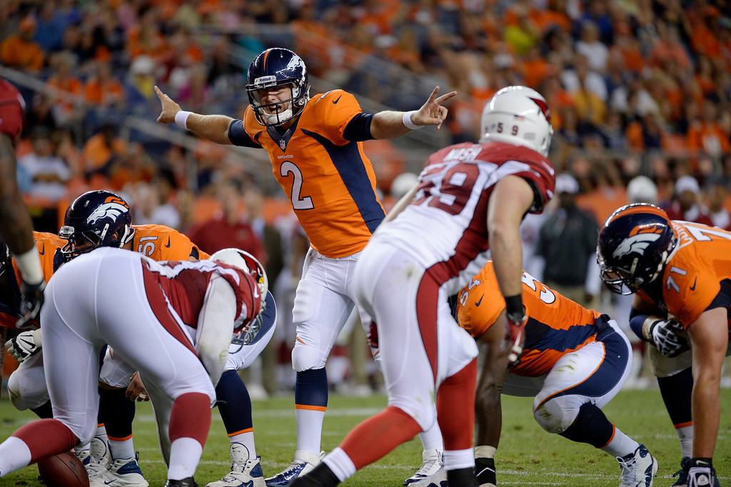 . Zac Dysert (2) of the Denver Broncos calls out a play against the Arizona Cardinals during the last pre-season game of the season at Sports Authority Field at Mile High. August 29, 2013 Denver, Colorado. (Photo By Joe Amon/The Denver Post)