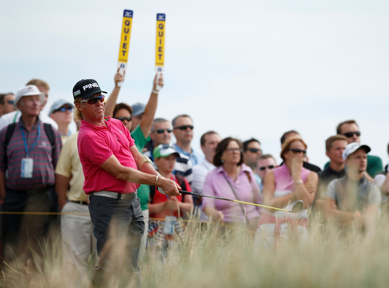 . Miguel Angel Jimenez of Spain plays a shot off the 14th tee during the first round of the British Open Golf Championship at Muirfield, Scotland, Thursday July 18, 2013. (AP Photo/Matt Dunham)