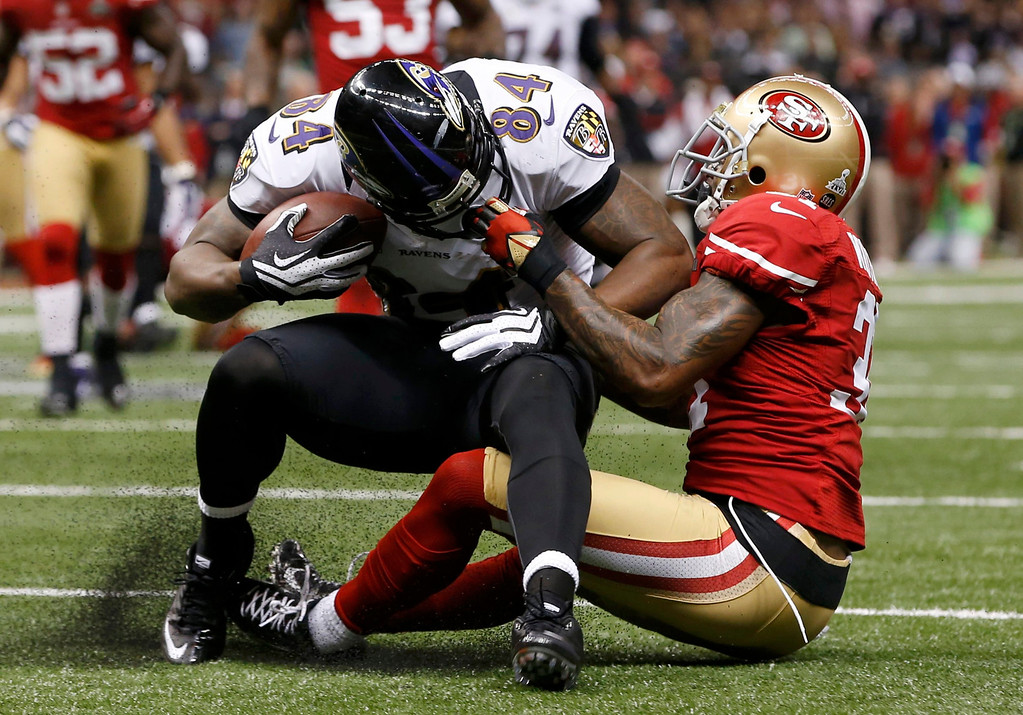 . San Francisco 49ers strong safety Donte Whitner (31) is called for a face mask penalty as he brings down Baltimore Ravens tight end Ed Dickson (84) during the second quarter in the NFL Super Bowl XLVII football game in New Orleans, Louisiana, February 3, 2013. REUTERS/Mike Segar