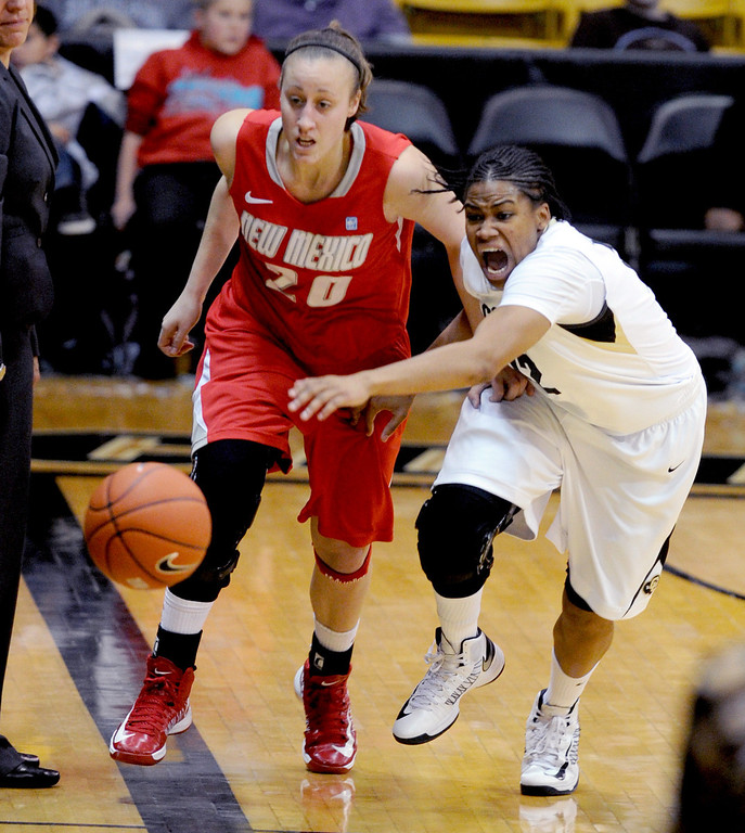 . Sara Halasz, left,  of New Mexico, and Ashley Wilson, chase down the ball in the second half. Cliff Grassmick / December 29, 2012