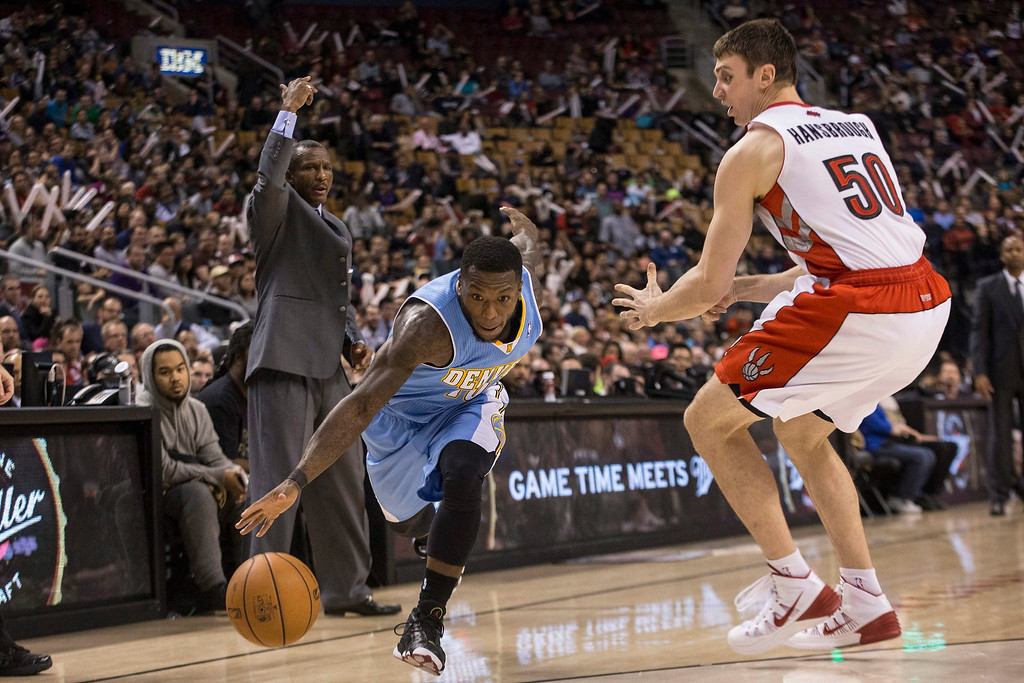 . Denver Nuggets\' Nate Robinson, left, drives past Toronto Raptors\' Tyler Hansbrough during the second half of an NBA basketball game on Sunday, Dec. 1, 2013, in Toronto. (AP Photo/The Canadian Press, Chris Young)