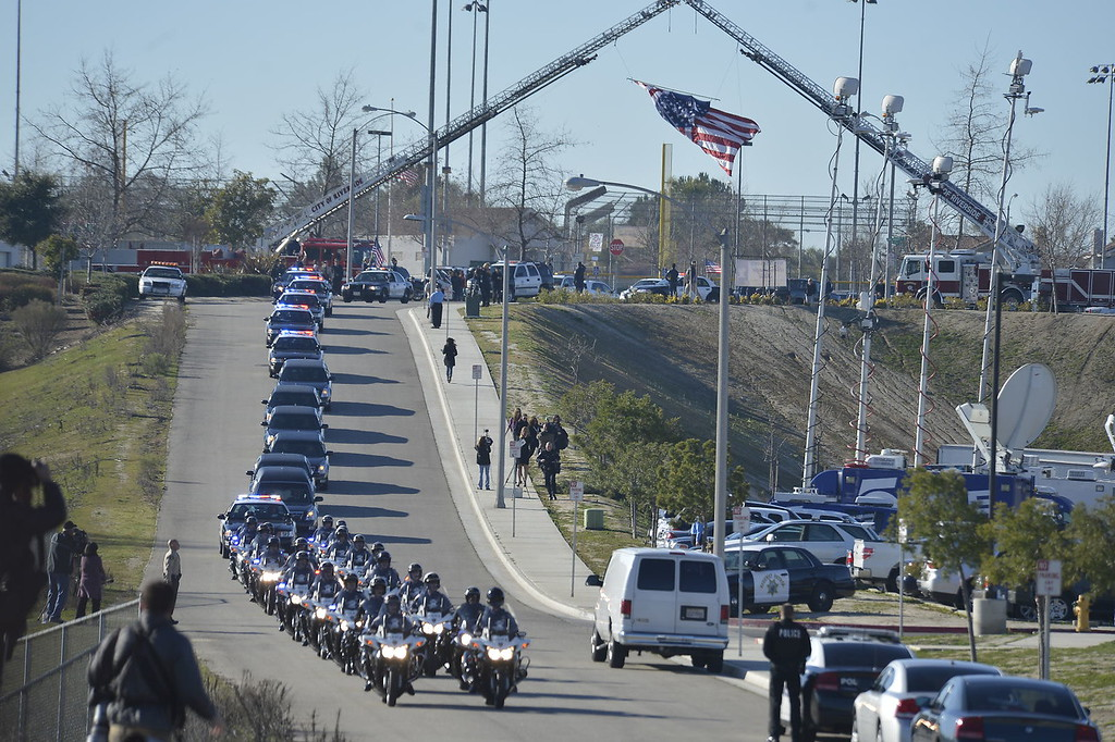 . Today\'s funeral for fallen Riverside police Officer Michael Crain to draw thousands, including Gov. Jerry Brown.  The service, to be held at 10:30 a.m. at Grove Community Church, 19900 Grove Community Drive in Riverside, has increased security.  (Jeff Gritchen/Staff Photographer)