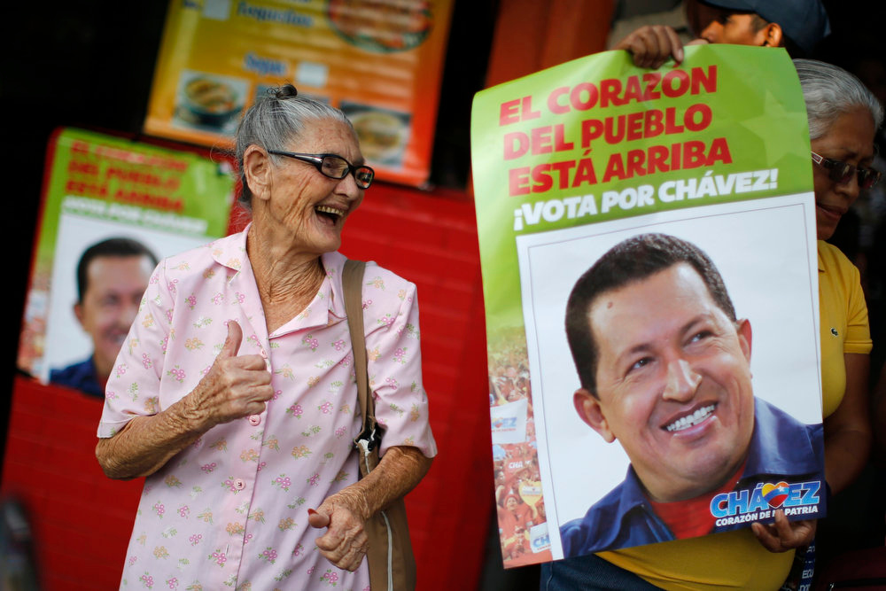 Description of . A supporter of Venezuela's President Hugo Chavez cheers outside the military hospital after his surprise return to Caracas February 18, 2013. Chavez made a surprise return from Cuba on Monday more than two months after surgery for cancer that has jeopardized his 14-year rule of the South American OPEC member. The 58-year-old socialist leader underwent a six-hour operation in Cuba on December 11. He had not been seen or heard in public since then until photos were published of him on Friday. REUTERS/Jorge Silva