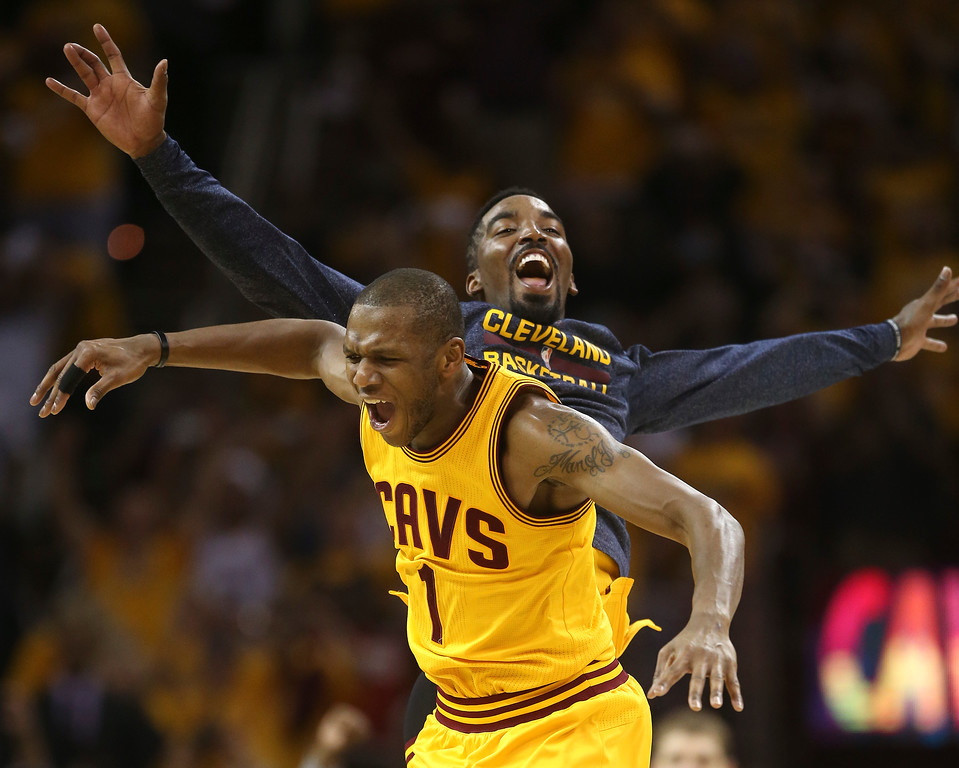 . Cleveland Cavaliers forward James Jones (1) celebrates with guard J.R. Smith after the Cavaliers beat the Atlanta Hawks 118-88 in  Game 4 of the NBA basketball Eastern Conference Finals, Tuesday, May 26, 2015, in Cleveland. (AP Photo/Ron Schwane)
