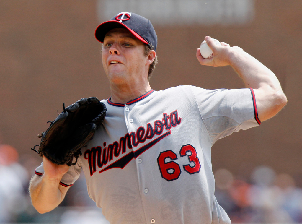 . Twins starter Andrew Albers delivers against the Tigers in the first inning. (AP Photo/Duane Burleson)