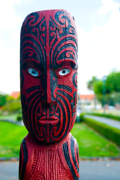 Carved moari figure in Rotorua New Zealand
