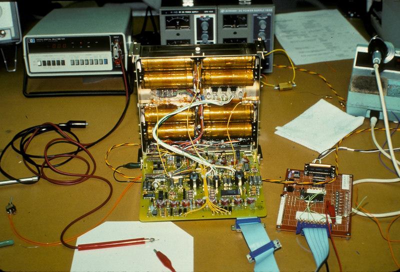 The ARRL Labs (KE3Z, Jon Bloom) built the battery charge regulator.  The golden cylinders are Ni-Cad cells.
