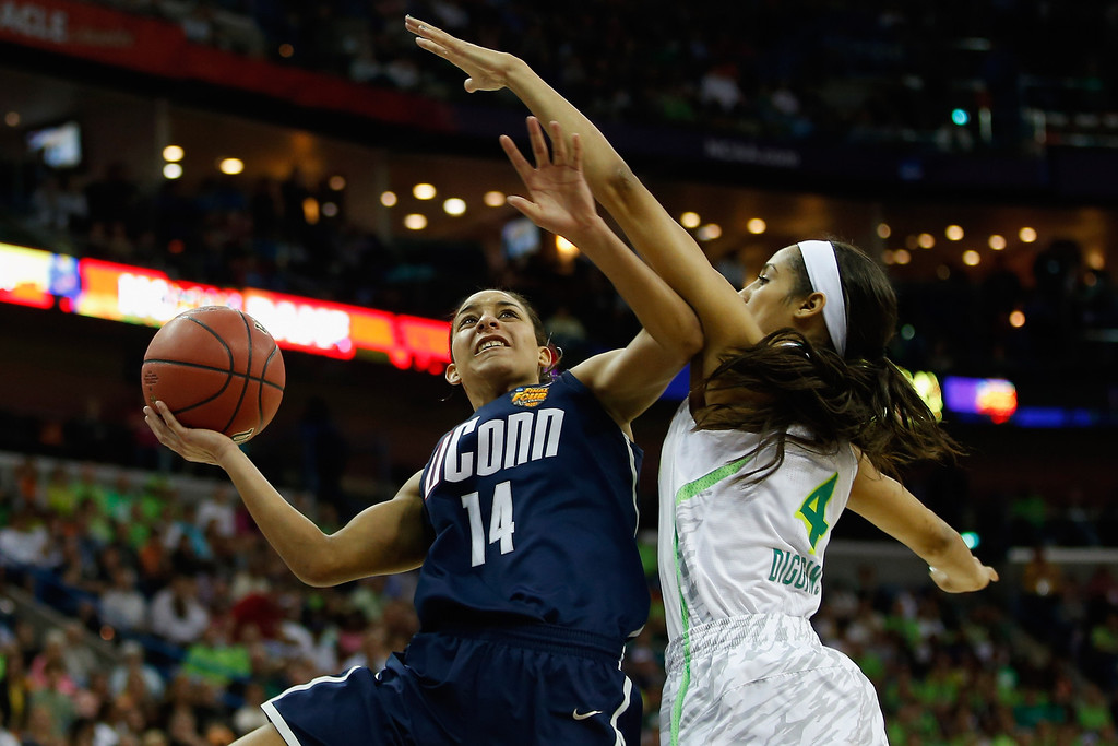 . Bria Hartley #14 of the Connecticut Huskies shoots the ball over Skylar Diggins #4 of the Notre Dame Fighting Irish during the National Semifinal game of the 2013 NCAA Division I Women\'s Basketball Championship at the New Orleans Arena on April 7, 2013 in New Orleans, Louisiana.  (Photo by Chris Graythen/Getty Images)