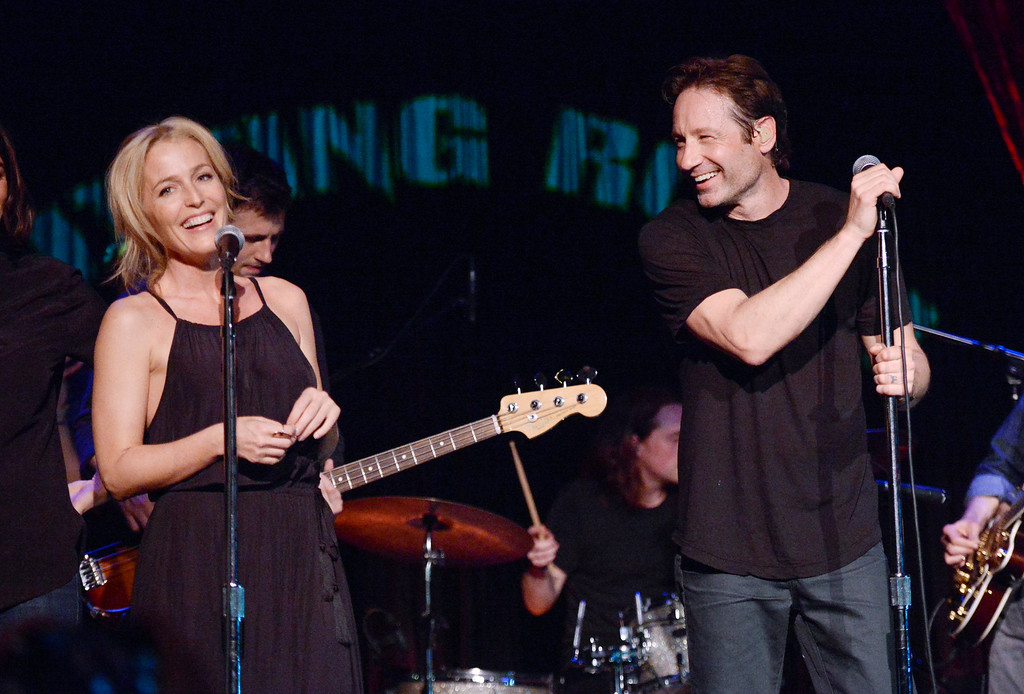 """. David Duchovny is joined by actress Gillian Anderson during his performance at The Cutting Room, in support of the release of his debut album \""""Hell Or Highwater\"""", on Tuesday, May 12, 2015, in New York. (Photo by Evan Agostini/Invision/AP)"""