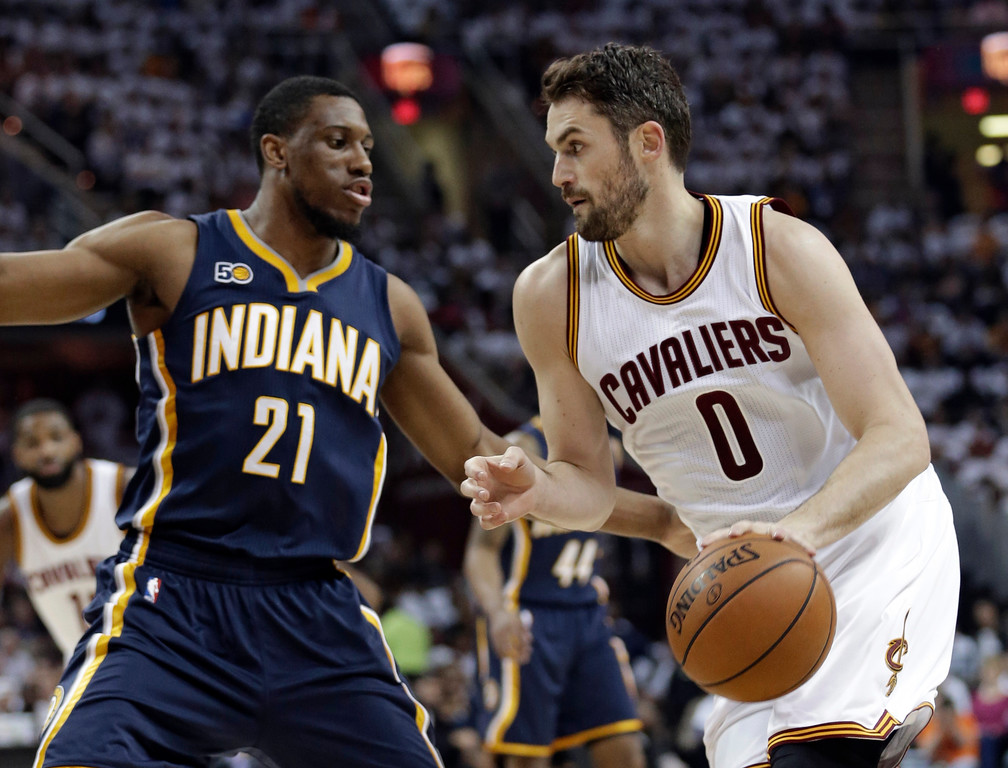 . Cleveland Cavaliers\' Kevin Love (0) drives past Indiana Pacers\' Thaddeus Young (21) in the first half in Game 1 of a first-round NBA basketball playoff series, Saturday, April 15, 2017, in Cleveland. The Cavaliers won 109-108. (AP Photo/Tony Dejak)