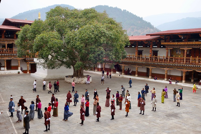 practicing a dance in the Punakha Dzong courtyard