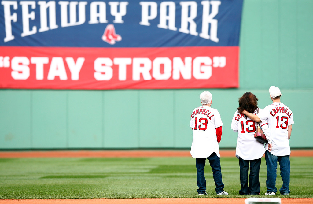 . BOSTON, MA - OCTOBER 04:  Boston Marathon bombing survivors take the field prior to Game One of the American League Division Series between the Boston Red Sox and the Tampa Bay Rays at Fenway Park on October 4, 2013 in Boston, Massachusetts.  (Photo by Jared Wickerham/Getty Images)