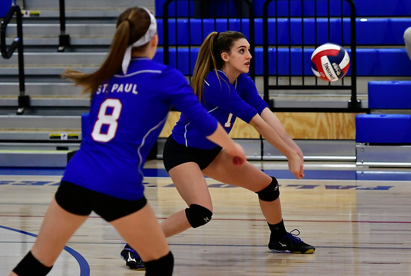 11/7/2018 Mike Orazzi | Staff St. Paul Catholic High School's Alexis Carabetta (8) and Olivia Genovese (11) during the Class S Second Round Girls Volleyball Tournament with Immaculate in Bristol Wednesday night.