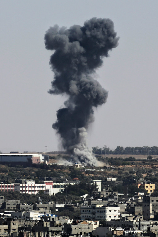 . Smoke rises after an Israeli missile strike hit the northern Gaza Strip, Wednesday, July 16, 2014. Israeli war planes and naval vessels intensified attacks across the Gaza Strip on Wednesday, targeting senior Hamas leaders and bombarding a coastal area, where four Palestinian boys were killed. (AP Photo/Adel Hana)