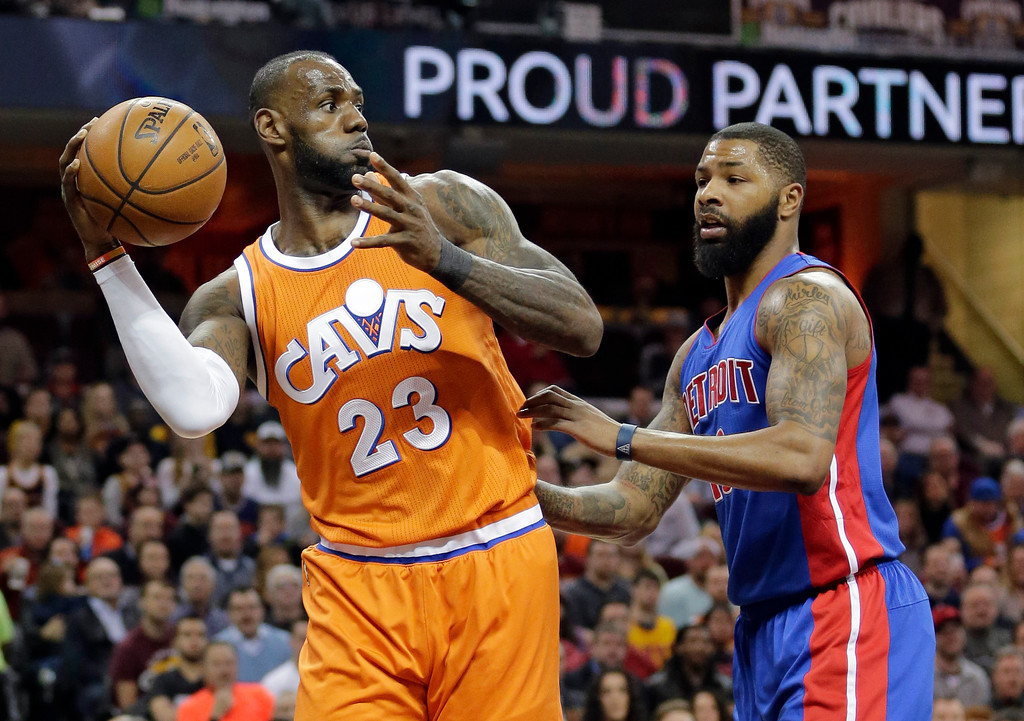 . Cleveland Cavaliers\' LeBron James, left, passes against Detroit Pistons\' Marcus Morris (13) in the first half of an NBA basketball game, Tuesday, March 14, 2017, in Cleveland. (AP Photo/Tony Dejak)