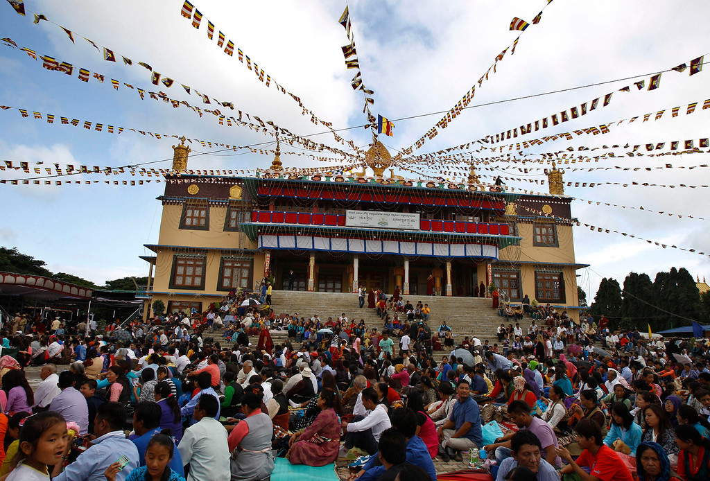 ". Tibetans living in exile listen to their spiritual leader the Dalai Lama during an event organized to celebrate his 78th birthday at a Tibetan Buddhist monastery in Bylakuppe, about 220 kilometers (137 miles) southwest of Bangalore, India, Saturday, July 6, 2013. Speaking after an interfaith meeting, he said 150,000 Tibetans living abroad represent ""6 million Tibetans (in China) who have no freedom or opportunity to express what they feel.\"" (AP Photo/Aijaz Rahi)"