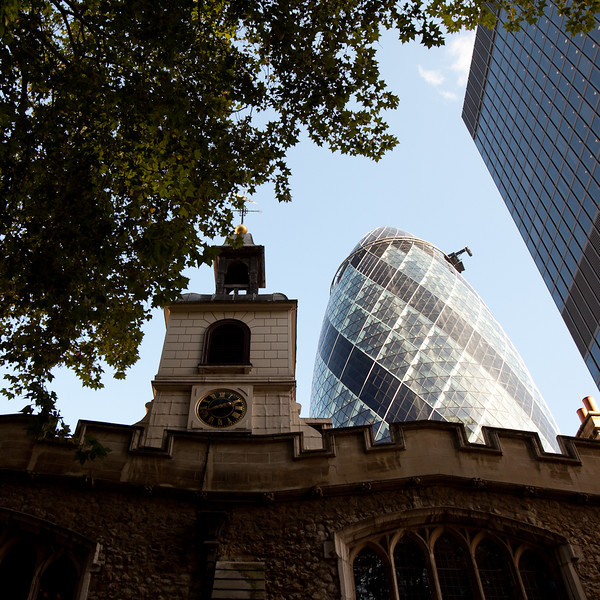 St Mary's church, parts of which still stand from its original construction in the 12th century against the background of the Gherkin.