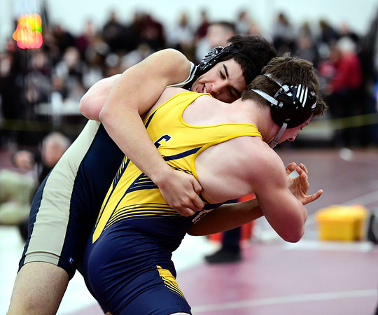 2/16/2019 Mike Orazzi | Staff Simsbury's Brett Araniti and Newington's Aidan Lozada during the CIAC state open wrestling tournament at Bristol Central High School in Bristol Saturday.
