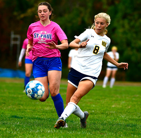 10/12/2019 Mike Orazzi | StaffrSt. Paul's Abbey Stanford (6) and Woodstock Academy's Grace Gelhaus (8) in Bristol on Saturday.