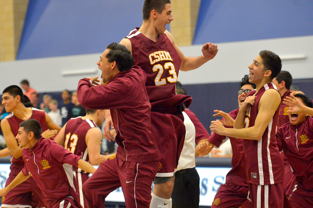 . Members of the Cantwell-Sacred Heart\'s boys basketball react after defeating Sierra Canyon in the Division IV state regional semifinal game in Chatsworth, CA March 18, 2014.(Andy Holzman/Los Angeles Daily News)