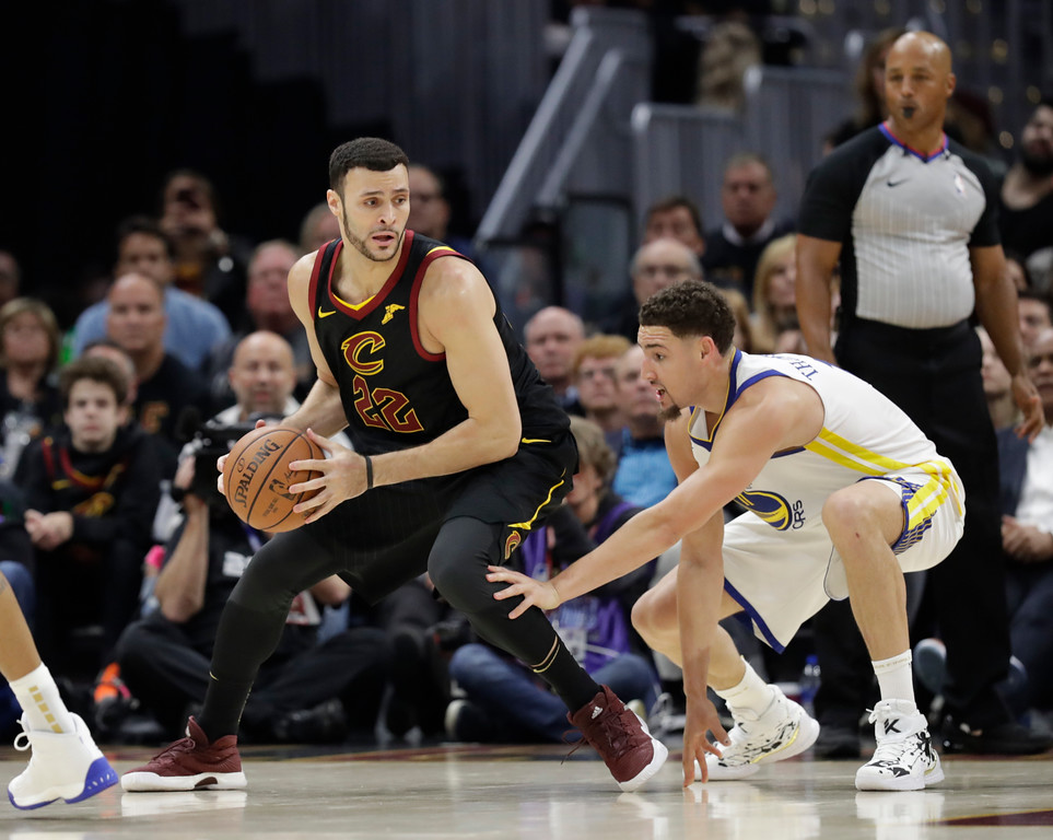 . Cleveland Cavaliers\' Larry Nance Jr. is defended by Golden State Warriors\' Klay Thompson in the first half of Game 3 of basketball\'s NBA Finals, Wednesday, June 6, 2018, in Cleveland. (AP Photo/Tony Dejak)