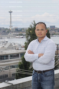 Accelerator chief executive Thong Le is pictured in front of the Seattle, Washington skyline