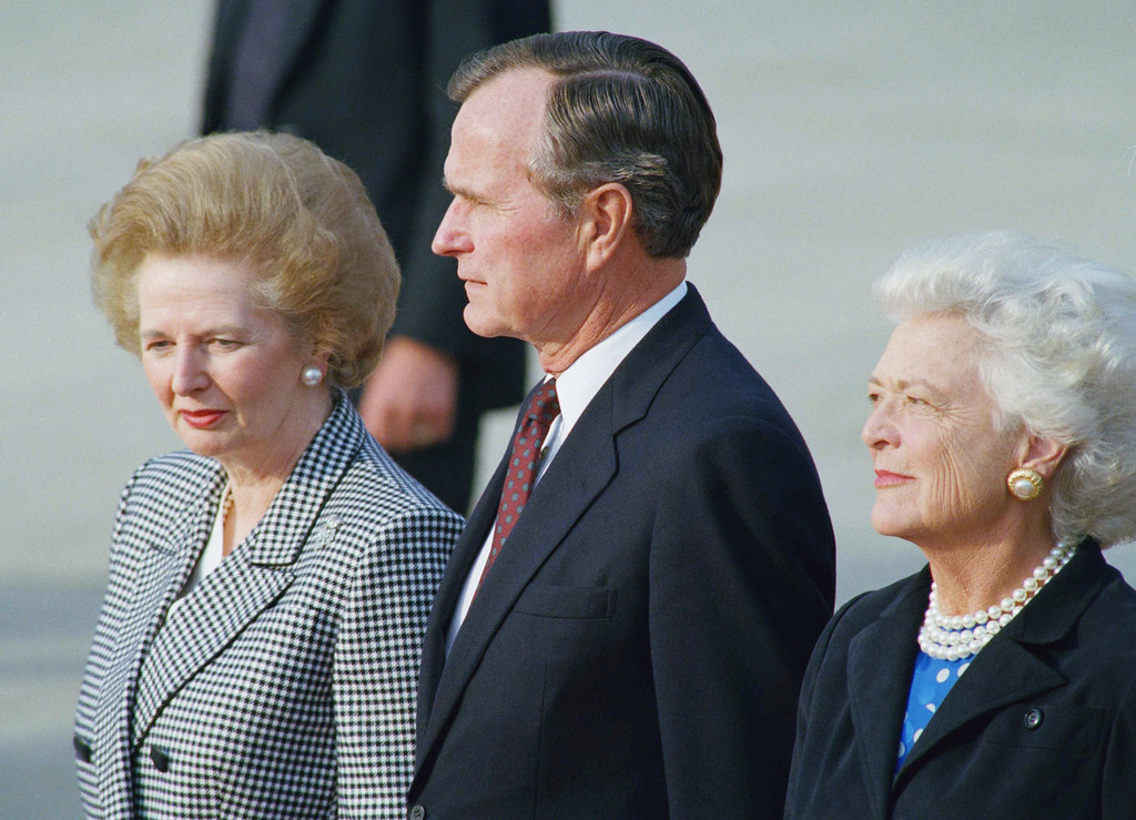 . U.S. President George Bush and Barbara Bush stand with Britain\'s Prime Minister Margaret Thatcher at London Heathrow Airport in London, after she welcomed him to London, Wednesday, May 31, 1989. President Bush is visiting London, on his way home following the NATO Summit in Brussels and a visit to West Germany. (AP Photo)
