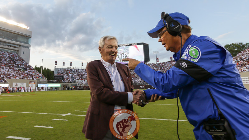 Former Virginia Tech head coach Frank Beamer (left) shakes hands with Duke head coach David Cutcliffe right before kickoff. (Mark Umansky/TheKeyPlay.com)