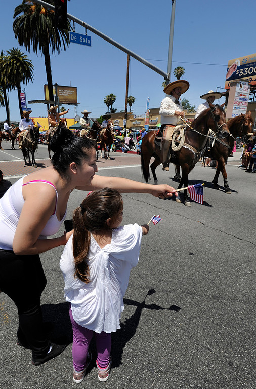 . Doama Rodriguez and her daughter Carolina,5, watch the parade. The Annual Canoga Park Memorial Day Parade marched down Sherman Way from Owensmouth east to Mason Street where it concluded at the First Baptist Church. Canoga park, CA 5/27/2013(John McCoy/LA Daily News)