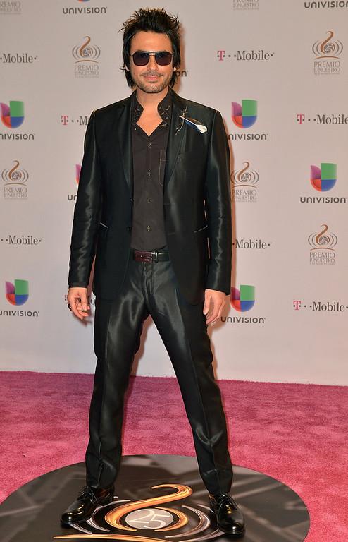 ". Beto Cuevas arrives at the 25th Anniversary Of Univision\'s \""Premio Lo Nuestro A La Musica Latina\"" on February 21, 2013 in Miami, Florida.  (Photo by Gustavo Caballero/Getty Images for Univision)"