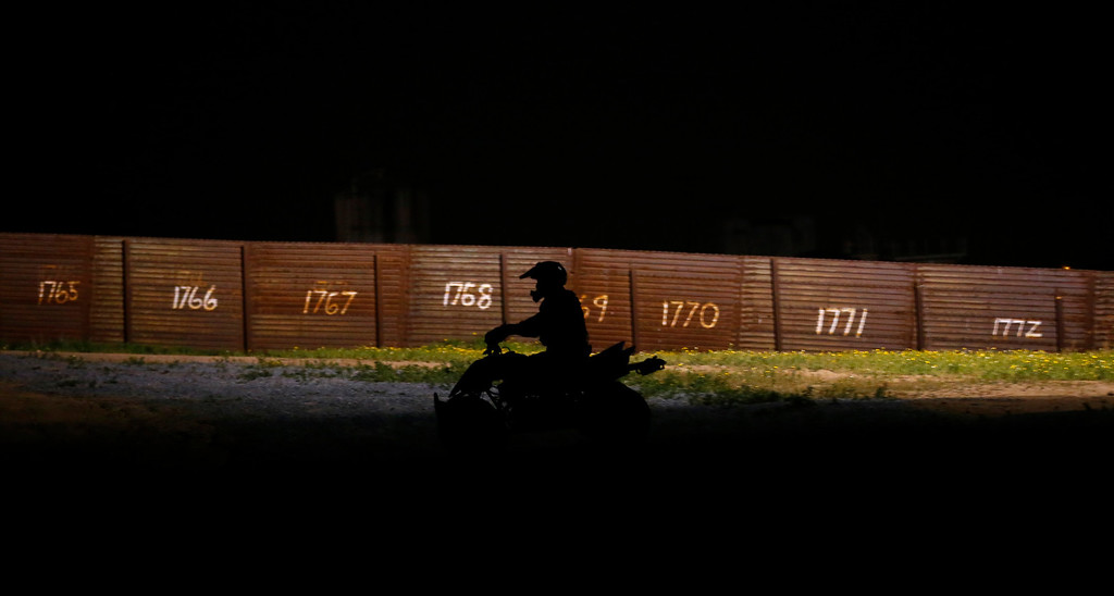 . A U.S. Customs and Border Patrol agent patrols on his ATV along the primary fence on the international border between Mexico and the United States near San Diego, California, March 26, 2013. Picture taken March 26, 2013. REUTERS/Mike Blake