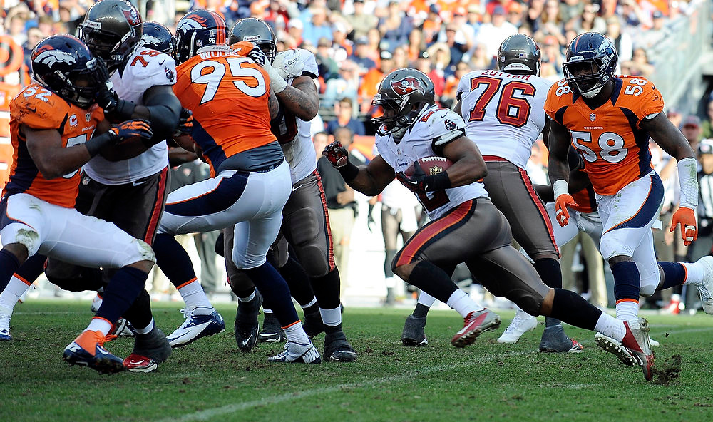 . DENVER - Tampa Bay Buccaneers running back Doug Martin turns the corner in the second quarter against the Denver Broncos Sunday at Sports Authority Field. Steve Nehf, The Denver Post