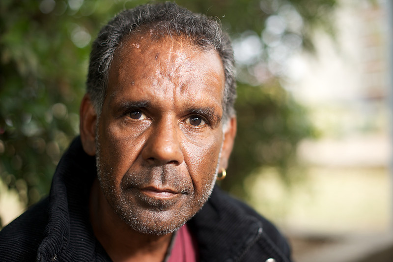 Aboriginal man in his mid 40s, looking at the camera