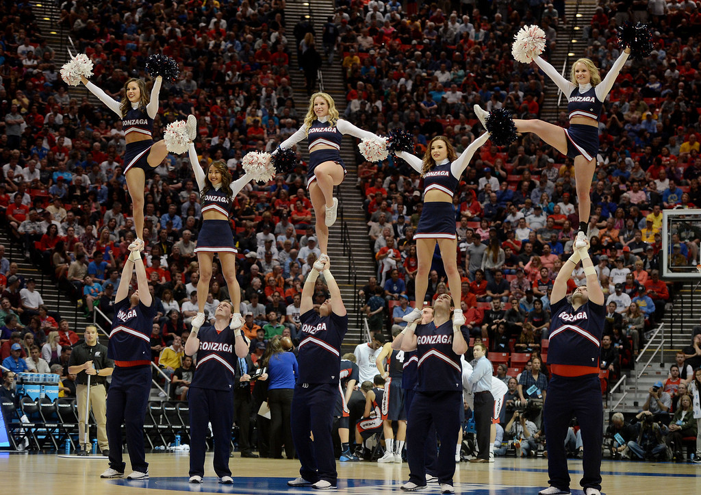 . Arizona Wildcats cheerleaders perform against the Gonzaga Bulldogs during the third round of the 2014 NCAA Men\'s Basketball Tournament at Viejas Arena on March 23, 2014 in San Diego, California.  (Photo by Donald Miralle/Getty Images)