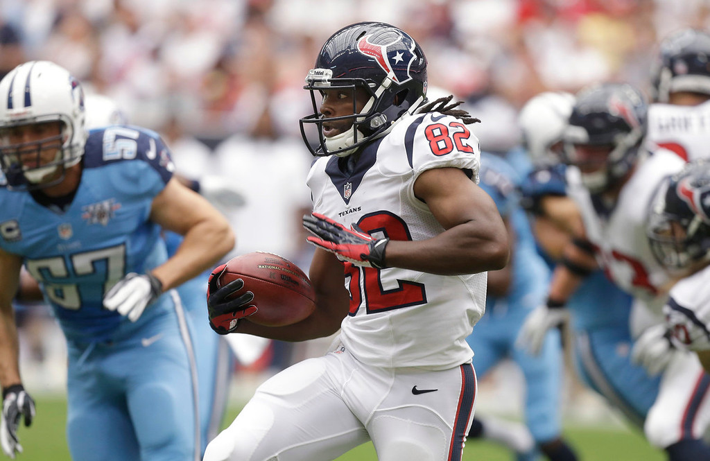 . Houston Texans\' Keshawn Martin (82) looks for yardage against the Tennessee Titans after a catch during the first quarter of an NFL football game on Sunday, Sept. 15, 2013, in Houston. (AP Photo/Patric Schneider)