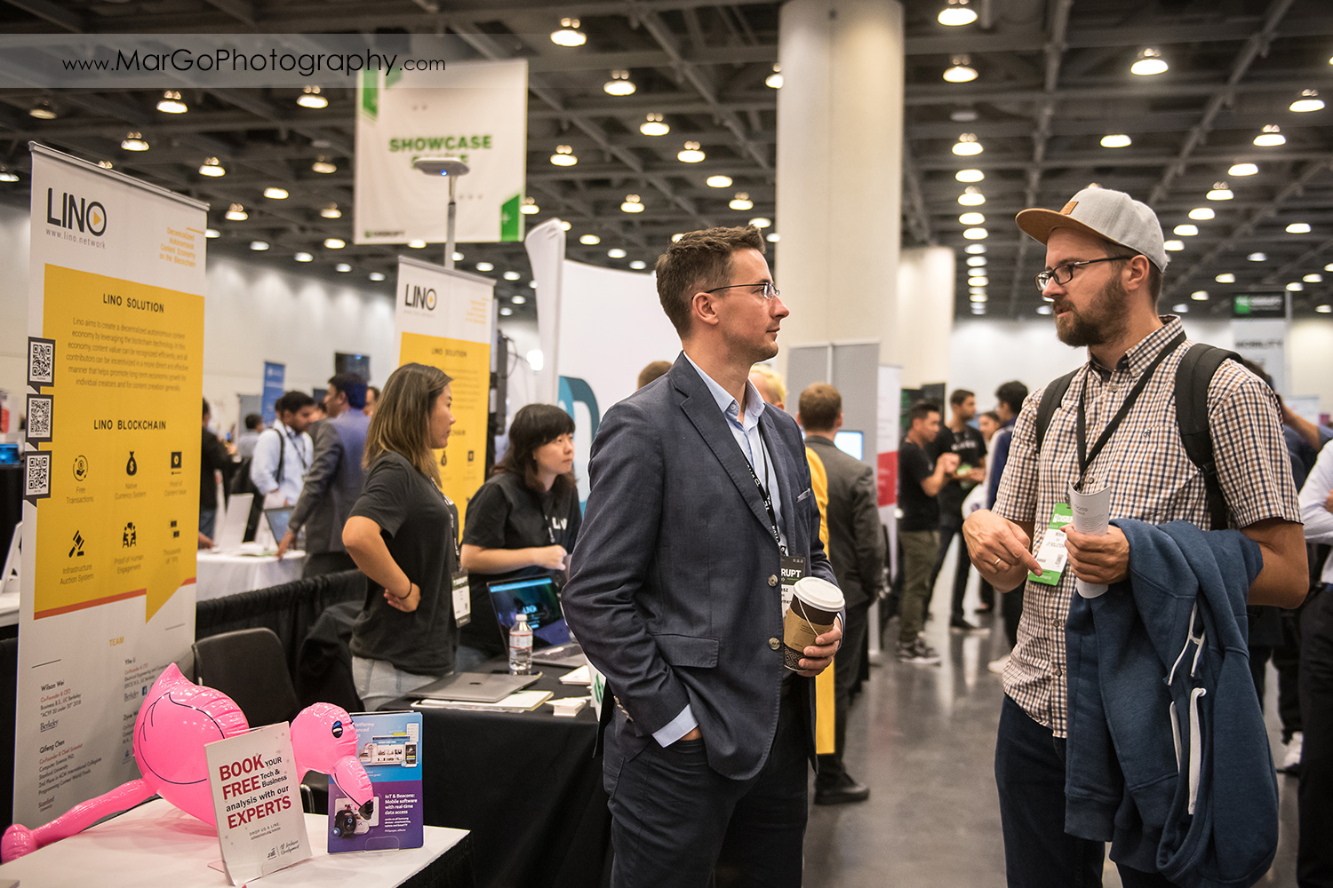 people in middle of the aisle at Disrupt SF at the Moscone Center West in San Francisco