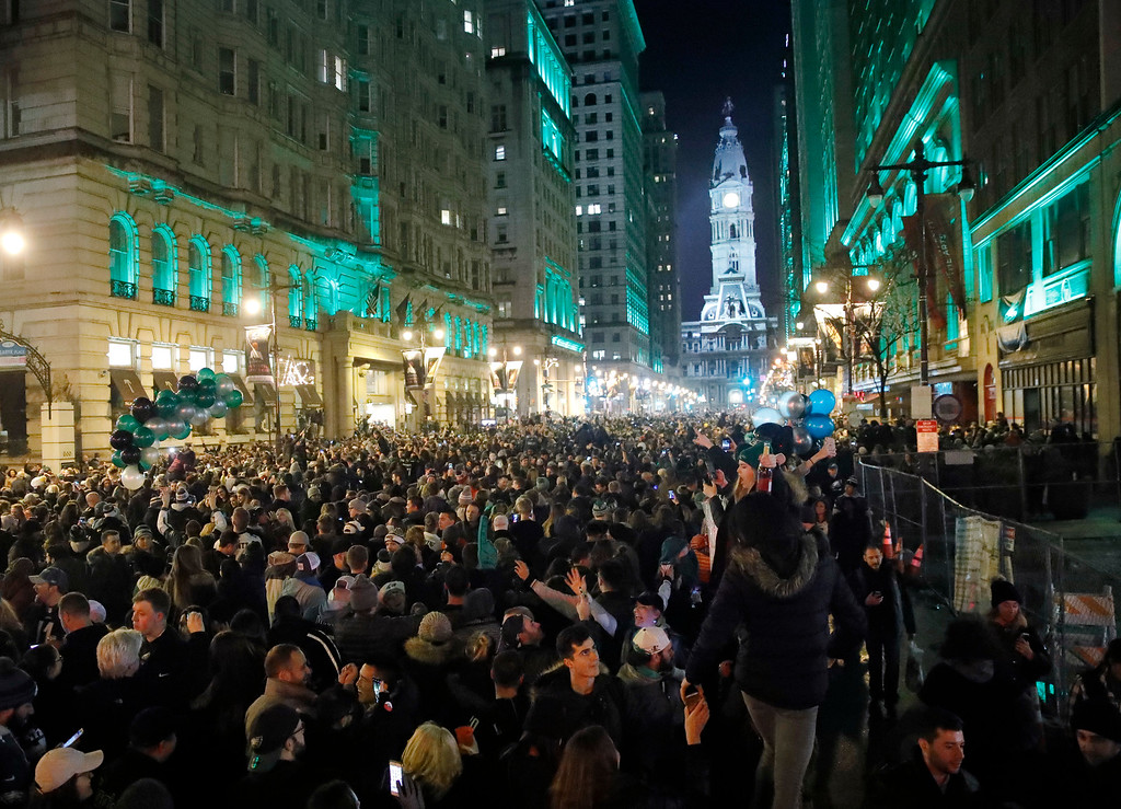 . Thousands of Philadelphia Eagles fans celebrate the team\'s victory in the NFL Super Bowl 52 against the New England Patriots, Sunday, Feb. 4, 2018, in downtown Philadelphia. (AP Photo/Matt Rourke)