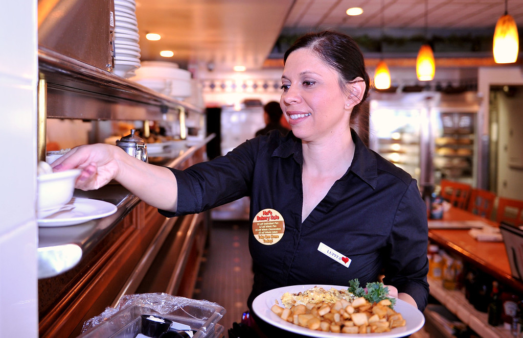 . 2/28/13 - Luita Becerra has worked 22 years at Hof\'s Hut, 6257 East 2nd Street in Long Beach. The home away from home for many was packed with customers on its\' final day of service Thursday. Hugs and farewells filled the booths as regulars came in for their last meal at the eatery. Some employees will transfer to other restaurants and they\'re hopeful their regulars will follow. Becerra  who met her husband when they were coworkers at the restaurant, 16 years ago, will be transferring to the Los Altos location. Photo by Brittany Murray / Staff photographer