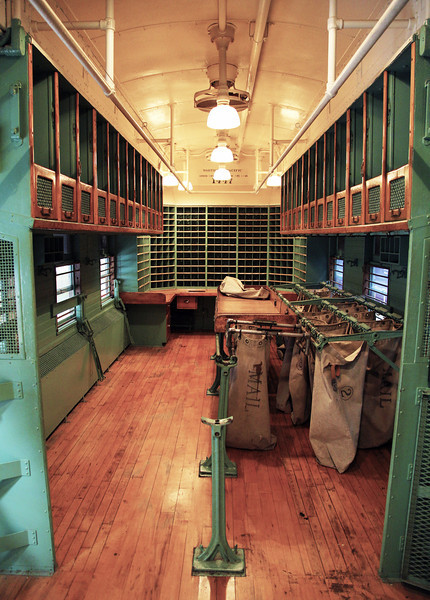 The rolling mail-room of an old railroad train.