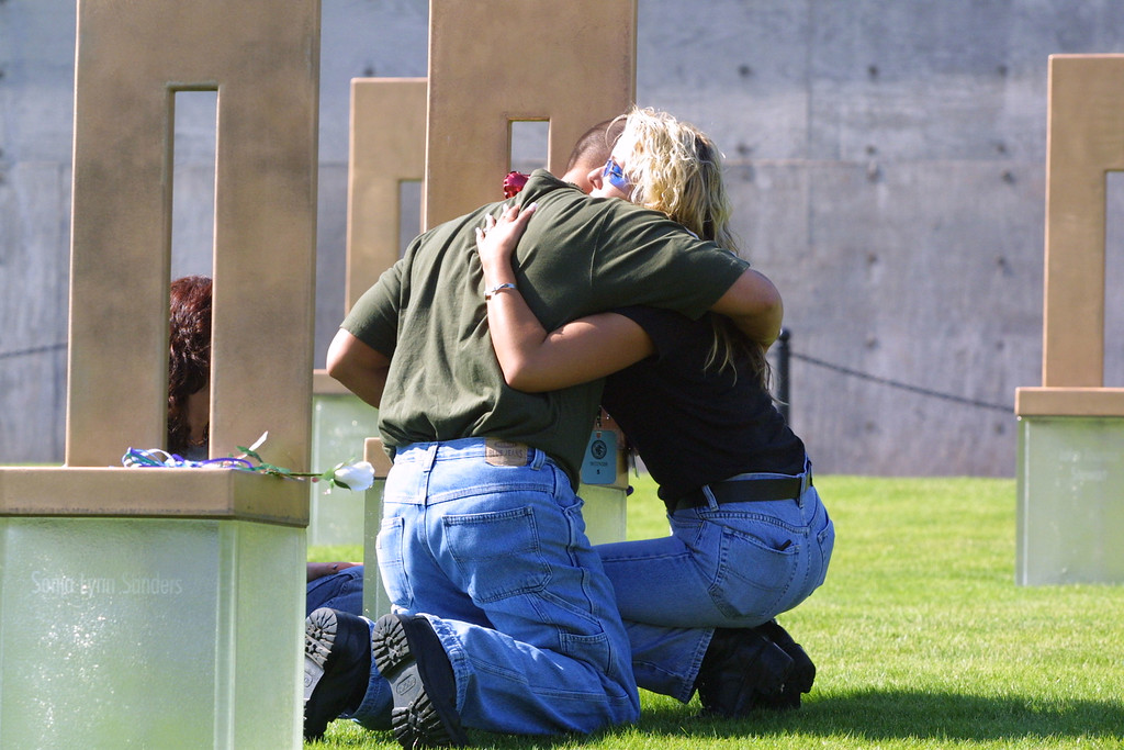 . Jay Sawyer and his wife Shari Sawyer hug as they mourn at the chair that represents Jay\'\'s mother Delores Stratton, June 11, 2001 at the Oklahoma National Memorial in Oklahoma City, Oklahoma. They came to the memorial after witnessing the execution of convicted bomber Timothy McVeigh on a closed-circuit broadcast. About 230 people watched the execution of McVeigh on a closed-circuit broadcast in Oklahoma City. (Photo by Joe Raedle/Getty Images)